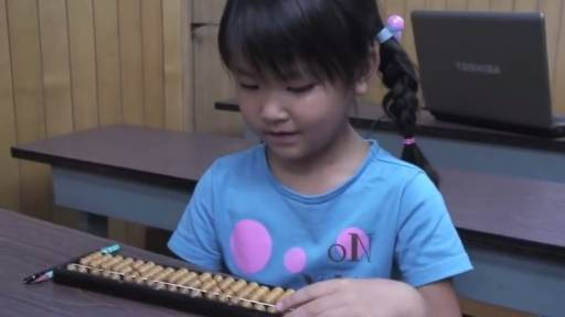 7-Year-Old Adds Huge Numbers Together with an Abacus