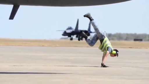 B-Boy Directs Planes on the Runway