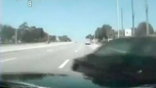 Driver Crashes into Cop Car and Keeps on Going...