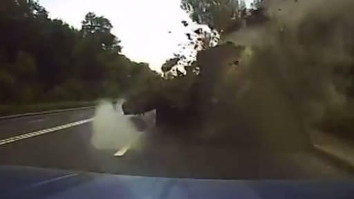 Missile Strike Lands a Few Feet Away From Speeding Car