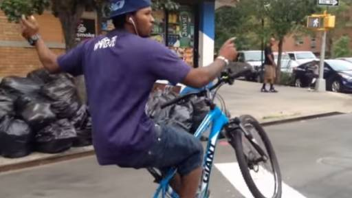 Bike Rider Dips and Dodges New York City Traffic