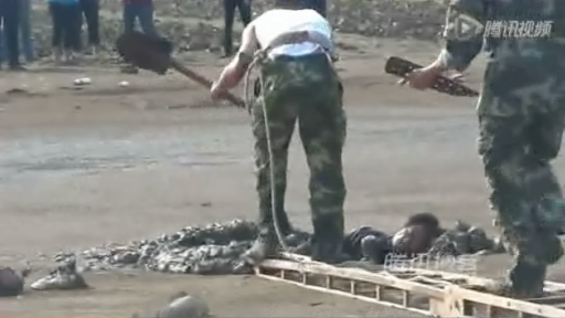 Elderly Man Stuck in Mud Is Pulled to Safety