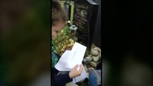 Touching Moment for Little Boy at Father's Gravesite