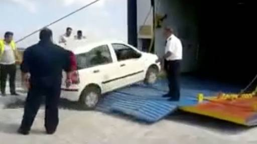 Rocking Ferry Boat Takes on Some Car Cargo