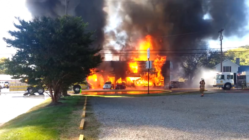 Firefighters Battle Intense Flames at Auto Repair Shop