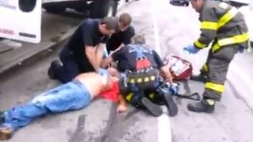 Bystanders Cheer on Firefighters to Save Man's Life