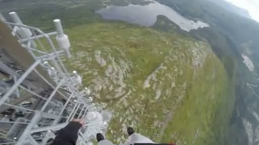 Men Showcase Landscape as They Dangle From Tower
