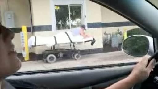 Man on Gurney Fulfills His McDonald's Needs