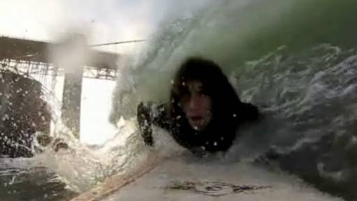 Kai the Hatchet-Wielding Homeless Hitchhiker Goes Surfing