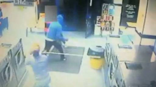 Robbers in Laundromat Beat Victim 