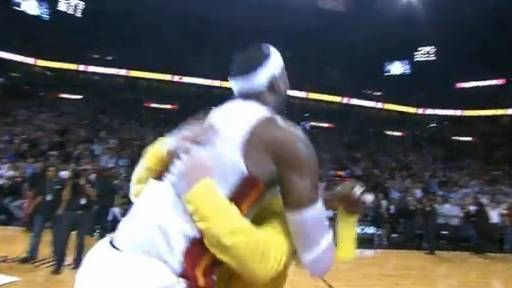 LeBron Tackles Heat Fan Who Makes $75,000 Shot