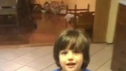 Dog's Inappropriate Behavior Interrupts Boy's Adorable Christmas Carol