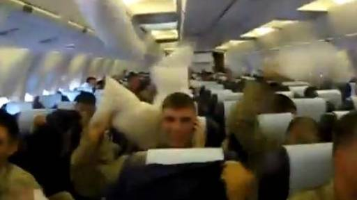 Marines Celebrate Safe Return With Pillow Fight Aboard Airplane