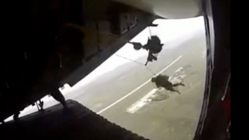 Scary Situation as Paratrooper's Parachute Hooks to Plane Leaving Him Dangling