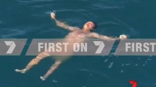 Naked Fisherman Rescued From Sharks