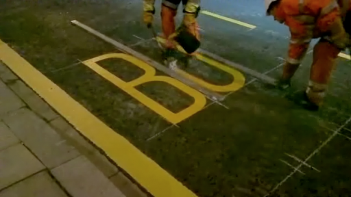 Prepare to Be Amazed by Guy Painting Road Markings
