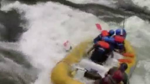 Rough Rapids Throw Paddlers Out of Raft