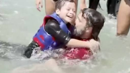Young Surfer With Spina Bifida Rides Waves