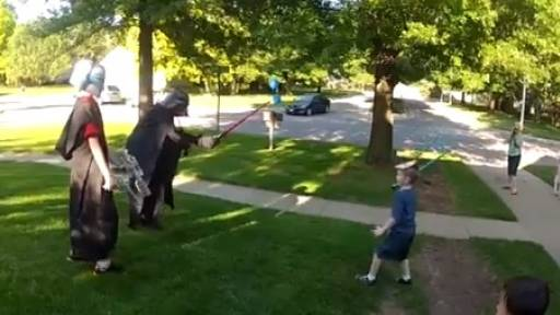 While Fighting Darth Vader, Boy Gets Surprised