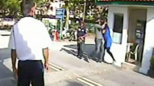 Guard Stands by as Woman is Mugged