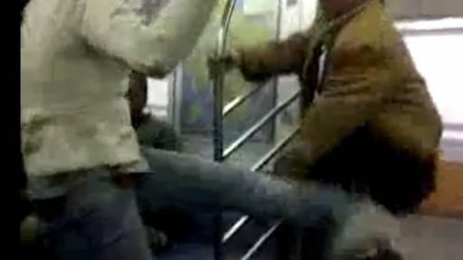 Man Breaks Up Subway Fight... While Having a Snack