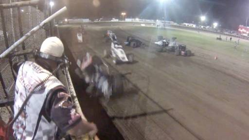 The Flagman at a Racetrack gets a Little Too Close to the Action