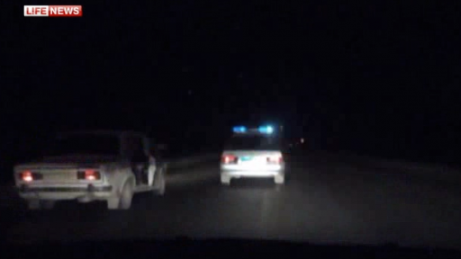 Russian Police Shoot Out Tires in High-Speed Chase