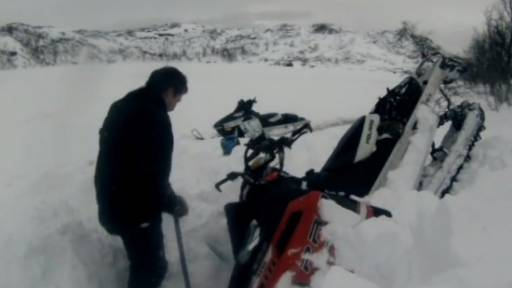 Tiny Avalanche Takes Down Snowmobiler
