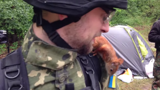Squirrel Plays With Soldiers