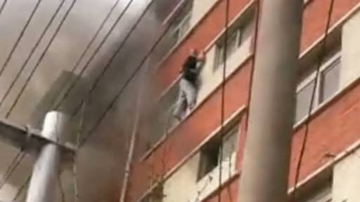 GRAPHIC: Man Falls From Burning Building