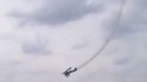 Biplane Crashes into Water at Air Show; Pilot Survives