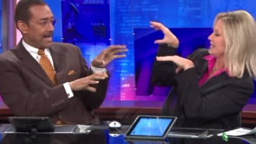 News Anchors Create Amazing Handshake at Commercial