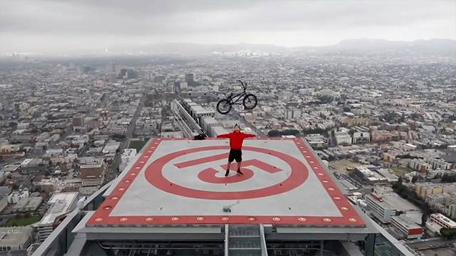 BMX Tricks Atop Helicopter Landing Pad | RTM - RightThisMinute