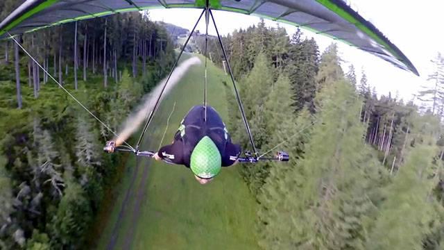 Speed Hang Glider Soars Down Ski Slope | RTM - RightThisMinute