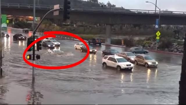 bold lamborghini driver takes on high flooding | rtm - rightthisminute